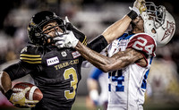 Portfolio image of CFL football action showing a double face mask infraction photographed by award-winning Toronto based photographer Peter Power.